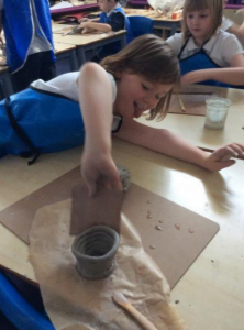 Creating our Greek pots out of clay